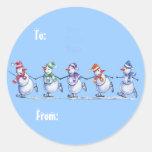 Muñecos de nieve en etiquetas del regalo del hielo