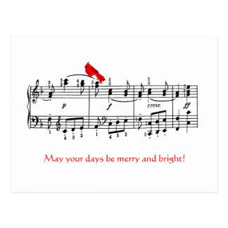 Música y postal roja cardinal del navidad del