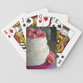 Naipes con la torta rosada y blanca en la parte
