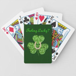 Naipes del trébol y de la herradura cartas de juego