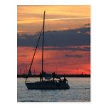 Navegación @ de puesta del sol tarjetas postales