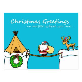 Navidad de Santa y del reno que saluda la postal