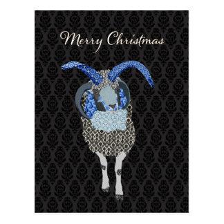 Navidad del negro de la postal de las ovejas de Jo