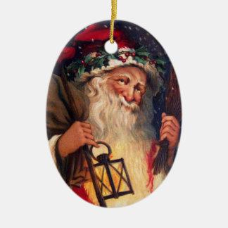 Navidad del padre con la linterna adorno navideño ovalado de cerámica