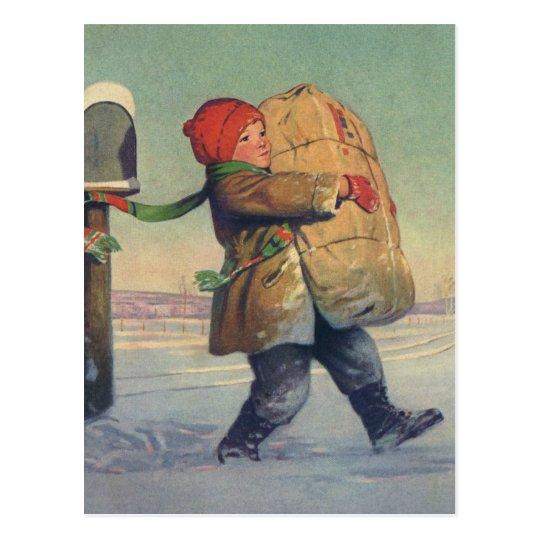 Navidad del vintage, niño con el paquete grande postal
