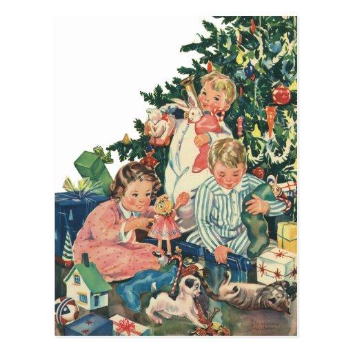 Navidad del vintage, niños que abren presentes postales