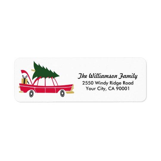 Navidad divertido de la familia que trae a casa el etiqueta de remite