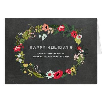 Navidad floral del hijo y de la nuera de la tarjeta de felicitación