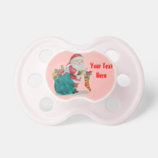Navidad lindo del padre con los juguetes y los chupetes de bebe