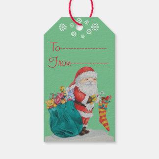 Navidad lindo del padre con los juguetes y los etiquetas para regalos