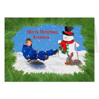 Navidad, nieto, muchacho en el trineo, muñeco de tarjeta de felicitación