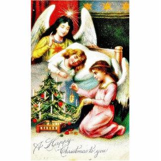 Navidad que saluda con los ángeles que adornan a u escultura fotográfica
