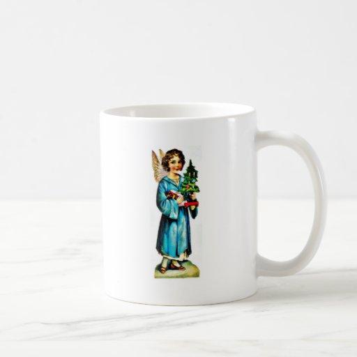 Navidad que saluda con un ángel que se coloca con  tazas