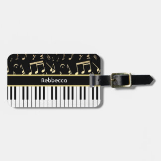 Negro y oro de las notas musicales y de las llaves etiquetas para maletas