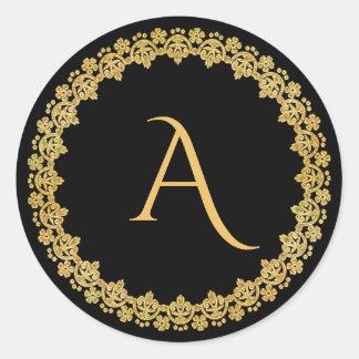 Negro y pegatina del monograma del navidad del oro
