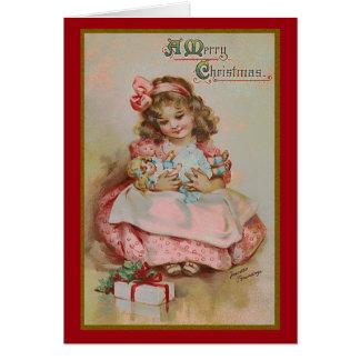 Niñez en la tarjeta de felicitación del navidad