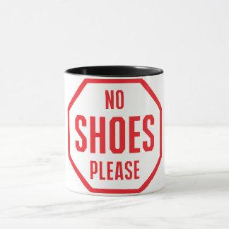 Ninguna taza de café de los zapatos