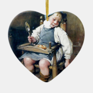 Niño que da la comida a la pintura de la adorno de cerámica en forma de corazón