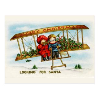 Niños del navidad del vintage que buscan Santa Postal