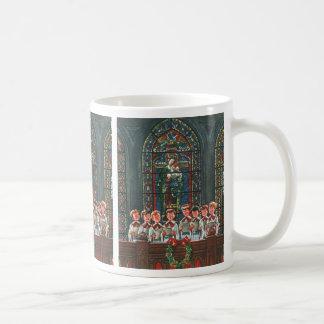 Niños del navidad del vintage que cantan al coro taza de café