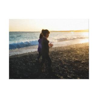 Niños en la puesta del sol impresión en lienzo