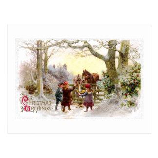 Niños que alimentan a caballos navidad antiguo tarjeta postal