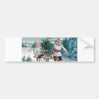 Niños que talan un árbol de navidad pegatina para coche