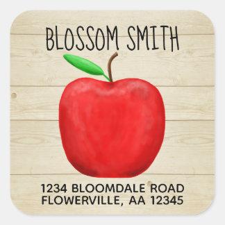 Nombre de Apple y pegatina rojos de la dirección