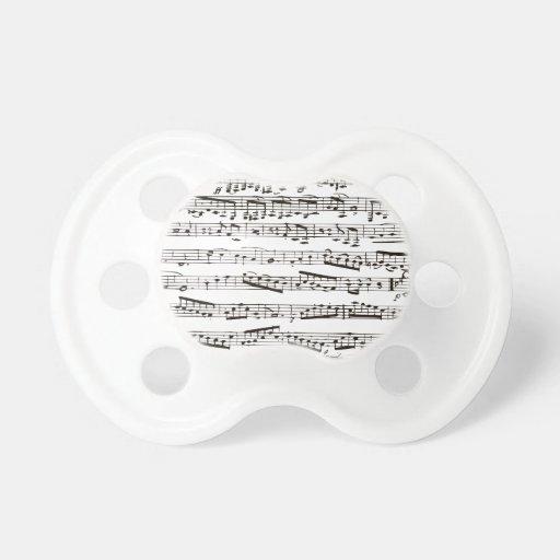 Notas musicales blancos y negros chupetes de bebe