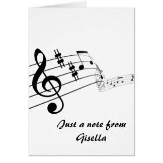 Notas musicales sobre el personal con la tarjeta de felicitación