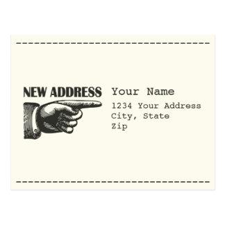 Nueva dirección que señala la mano postal