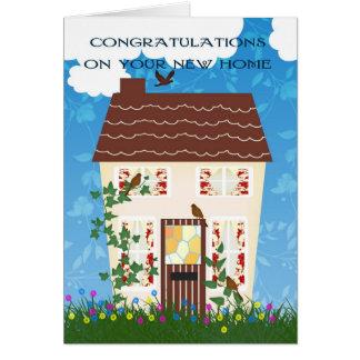 Nueva enhorabuena casera con una casa y las flores felicitación