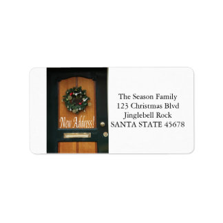 Nueva guirnalda del navidad de la dirección en etiquetas de dirección