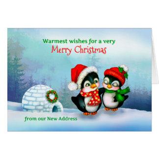 Nuevo navidad postal, pingüinos y iglú de la tarjeta de felicitación