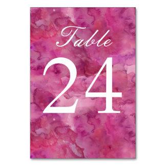Número magenta abstracto de la tabla del boda de