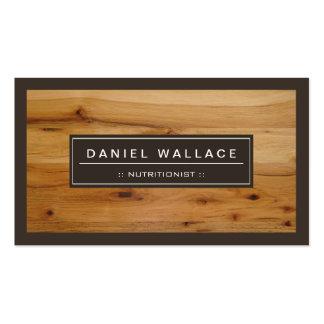 Nutricionista el dietético - mirada de madera con tarjetas de visita