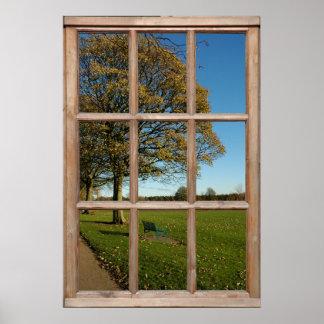 Opinión del parque del otoño de una ventana poster