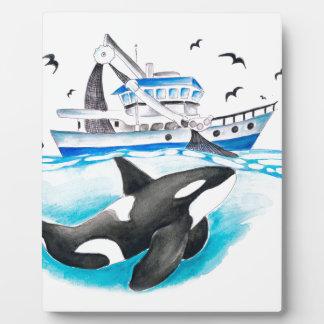 Orca y el barco placa expositora