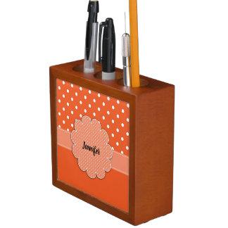 Organizador anaranjado y blanco del escritorio de