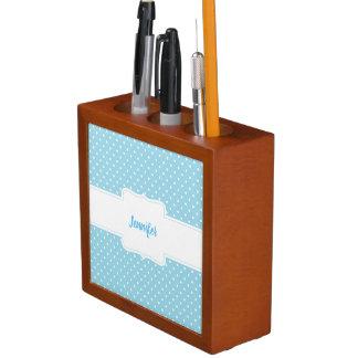 Organizador azul y blanco del escritorio de los