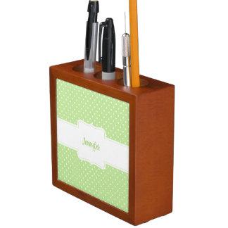 Organizador verde y blanco del escritorio de los