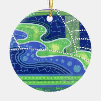 Ornamento abstracto azul y verde de la pintura adorno navideño redondo de cerámica