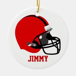 Ornamento rojo y negro del casco de fútbol adorno navideño redondo de cerámica