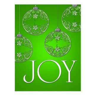 Ornamentos de la alegría en el verde esmeralda postal