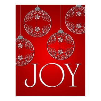Ornamentos de la alegría en elegante rojo de tarjeta postal