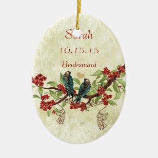Ornamentos rojos de la dama de honor del pájaro
