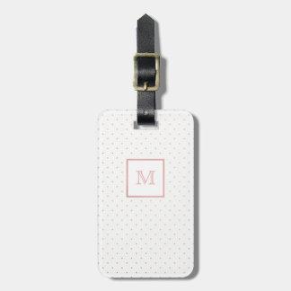 Oro color de rosa y etiqueta blanca del equipaje
