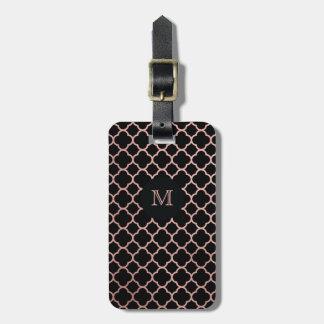 Oro color de rosa y etiqueta negra del equipaje