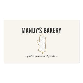 Oro del logotipo del mitón del horno en el beige p tarjetas de visita