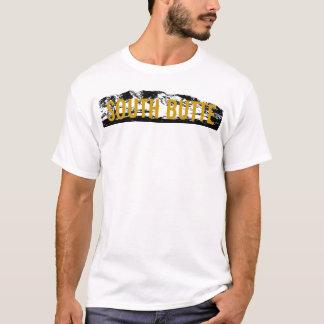 Oro del sur de la mota en la camiseta negra